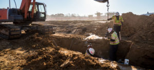 Workers digging a hole